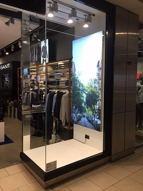 One side of the GANT Lakeside storefront showing LED light box in widow display