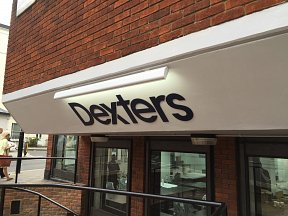 External illuminated sign at Dexters Pimlico Training Academy, London