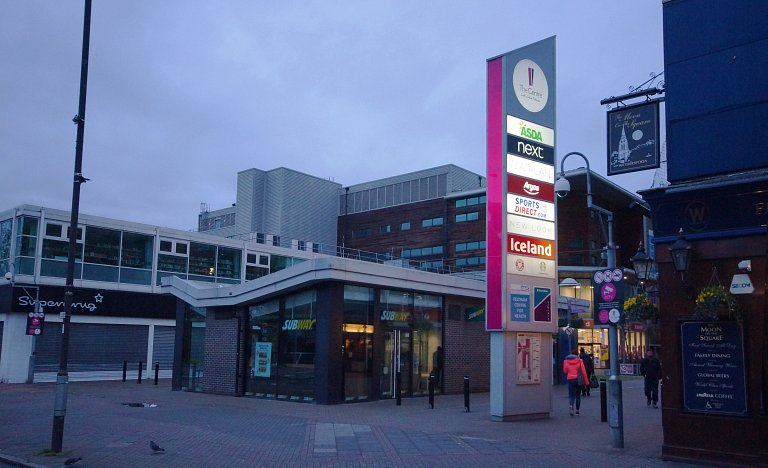 Large monolith with new LED lighting and branding at The Centre, Feltham