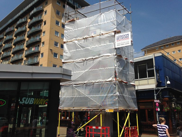 Scaffolding surrounding one of the large monoliths at The Centre, Feltham