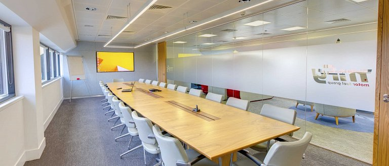 Frosted manifestations applied to the meeting room glass partitioning