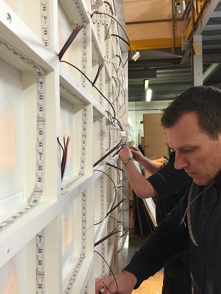 Operations Manager Glen working on an illuminated point of sale display